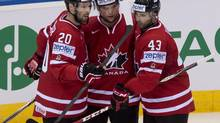 Team Canada Cody Hodgson, centre, is congratulated by teammates Troy Brouwer and Nazem Kadri, right after he scored the first goal against Denmark during first period Thursday, May 15, 2014 at the IIHF World Hockey Championship in Minsk, Belarus. (Jacques Boissinot/THE CANADIAN PRESS)