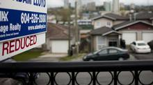 A duplex in the Vancouver suburb of Burnaby on the market earlier this month. The average cost of a Vancouver home is still more than $761,000, higher than anywhere else in the country. However, it was 3.1-per-cent lower in March than in the same month last year. (Rafal Gerszak for The Globe and Mail)