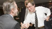 Paul Beeston, seen shaking hands with former Blue Jays president Paul Godfrey, has agreed to remain with the baseball club as its president and CEO. (FRANK GUNN/CP)