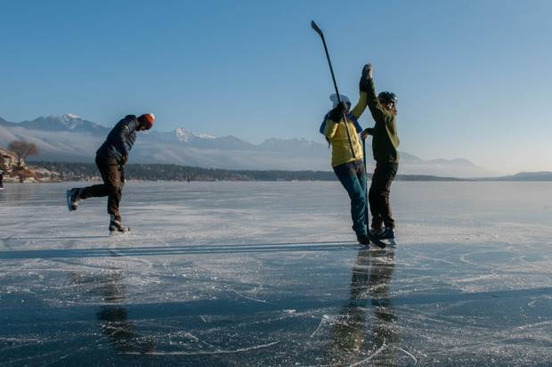 Skating and shinny on B.C.'s Lake Windermere.\
