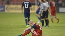 Toronto FC 's Richard Eckersley slumps to the floor after his team's 2-1 home defeat to Chicago Fire in MLS action in Toronto on Wednesday September 12, 2012. (Chris Young/THE CANADIAN PRESS)