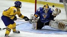 Finland goalie Noora Raty, right,makes a save against Sweden forward Erika Grahm in the quarterfinals of the World Women's Ice Hockey Championships, Wednesday, April 11, 2012, in Burlington, Vt. (Toby Talbot/AP)