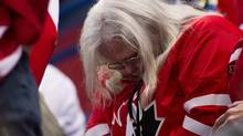 Canada fans hang their heads as Canada plays against Team USA during third period semi-final IIHF World Junior Championships hockey action in Ufa, Russia on Thursday, Jan. 3, 2013. (Nathan Denette/THE CANADIAN PRESS)