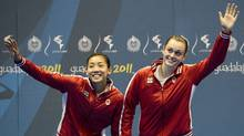 Canadian double's pair Alex Bruce, right, and Michelle Li, left, wave to the crowd while receiving gold after defeating the United States doubles Badminton during the 2011 Pan American Games in Guadalajara, Mexico on Wednesday, Oct. 19, 2011. (Nathan Denette/THE CANADIAN PRESS)