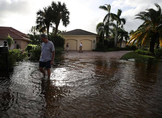 Bonita Springs, Fla., Sept. 11: People inspect their flooded neighborhood.
