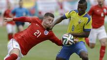 England's Ross Barkley (21) battles Ecuador's Edison Mendez (8) for control of the ball in the second half of a friendly soccer match in Miami Gardens, Fla., Wednesday, June 4, 2014. The game ended a 2-2 tie. (Alan Diaz/AP)