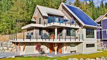 Six hundred square feet of steep solar panels convert sunlight into electricity to ensure the home creates as much energy as it consumes. (Joern Rohde)