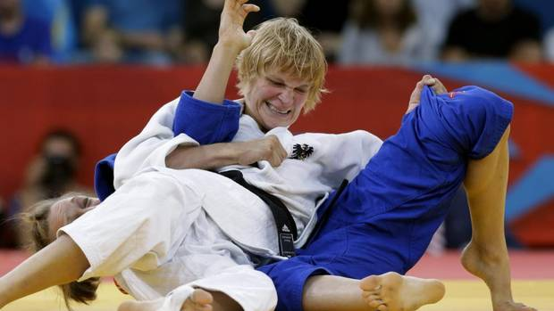 In an athletic competition as big as the Olympics, emotions run high. Emotions such as determination... (Sabrina Filzmoser of Austria, left, controls Joliane Melancon of Canada during the women's 57-kg judo competition at the 2012 Summer Olympics, Monday, July 30, 2012, in London.) (Paul Sancya/AP)