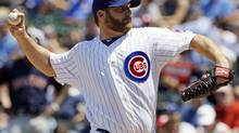 Chicago Cubs starter Ryan Dempster delivers a pitch against the Boston Red Sox during the second inning of an interleague baseball game in Chicago, Friday, June 15, 2012. (Nam Y. Huh/AP)