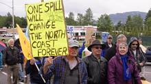 Protesters march through the streets of Kitimat, B.C., June 24, 2012. About 250 people rallied against the Northern Gateway Pipeline project, which would carry oil sands bitumen from Alberta to Kitimat for shipment to Asia. (Robin Rowland/THE CANADIAN PRESS)