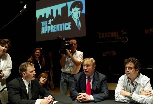 Donald Trump interviews potential contestants for his TV show, The Apprentice, in 2004.