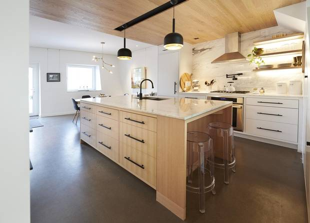 The kitchen's lowered ceiling enhances the home's hourglass effect.