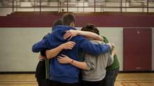 Students at a Cambridge, Ont., high school have a group hug as they participate in a day-long anti-bullying program. presented by Phil Boyte Apr. 25, 2012. (Moe Doiron/The Globe and Mail) (Moe Doiron/Moe Doiron/The Globe and Mail)