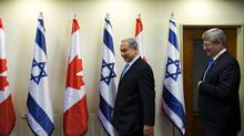 Israel's Prime Minister Benjamin Netanyahu (L) and Canada's Prime Minister Stephen Harper arrive for their meeting at Netanyahu's office in Jerusalem January 21, 2014. (ODED BALILTY/REUTERS)
