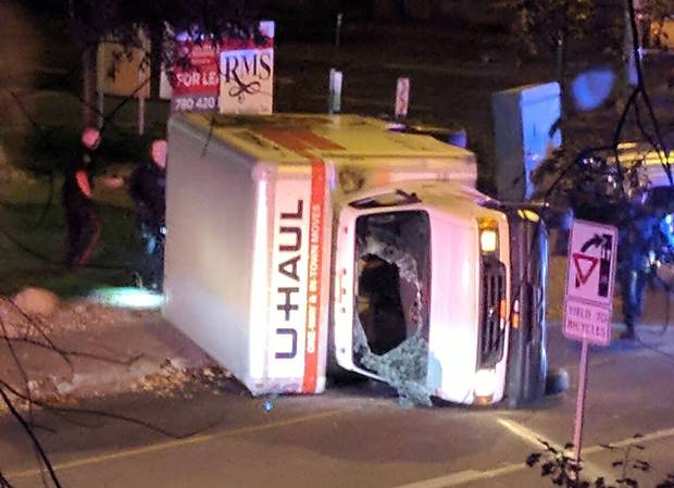 A rental truck lies on its side in Edmonton, Canada, on October 1, 2017, after a high speed chase.Canadian police arrested a man early Sunday suspected of stabbing an officer and injuring four pedestrians in a series of violent incidents being investigated as an