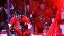 Ottawa Senators' right wing Daniel Alfredsson (11) steps on the ice again
