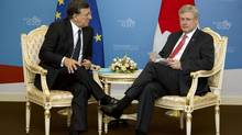 European Commission President Jose Manuel Barroso, left, and Canada's Prime Minister Stephen Harper meet on the sidelines of the G-20 summit in St. Petersburg, Russia on Friday, Sept. 6, 2013. (Virginia Mayo/AP)