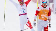 Brian McKeever and his guide Graham Nishikawa win the gold medal in the Men's 1km Sprint Visually Impaired Final (Matthew Murnaghan/Matthew Murnaghan/Canadian Paralympic Committee)