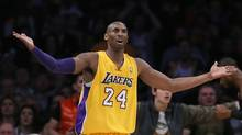 Los Angeles Lakers' Kobe Bryant reacts during their NBA basketball game against the Miami Heat in Los Angeles January 17, 2013. (LUCY NICHOLSON/REUTERS)