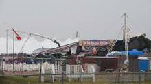 The collapsed main stage at the site of the Big Valley Jamboree in Camrose, Alta. is shown after a storm on August 1, 2009. Almost three dozen charges have been laid after a stage collapse that killed a woman at a country music festival in Alberta two years ago. (John Ulan/CP)