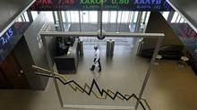 An employee crosses the lobby of the Athens stock exchange (LOUISA GOULIAMAKI/AFP/Getty Images)
