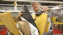 Canada Post employee Donna Yerxa sorts and scans packages in Scarborough on Dec. 13, 2013. (DEBORAH BAIC/THE GLOBE AND MAIL)