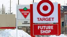 Canadian Tire posts a 'buy Canadian' message on its sign next to the new Target store in Guelph, Ont. that opened Tuesday, March 5, 2013. (Dave Chidley/THE CANADIAN PRESS)