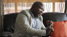 Thamsanqa Jantjie gestures at his home during an interview with the Associated Press in Johannesburg on Dec. 12, 2013. (Tsvangirayi Mukwazhi/Associated Press)