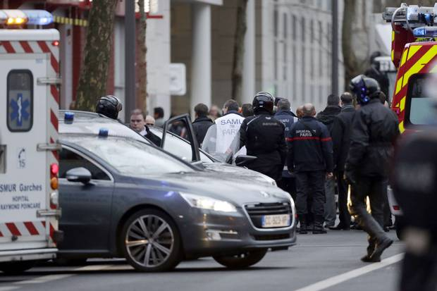 Police officers, firefighters and rescue workers gather at the site of a shooting on the morning of Jan. 8, 2015, in Montrouge, south of Paris.
