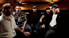 Canadian rock group Alexisonfire, left to right, Chris Steele, Dallas Green, George Pettit, Jordan Hastings, and Wade MacNeil pose for a photograph in Toronto on Wednesday, June 17, 2009. (Darren Calabrese/THE CANADIAN PRESS)