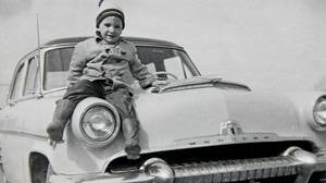 Peter Cheney with one of his grandfather's gas-guzzler cars in the late 1950s.