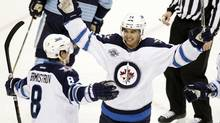 Winnipeg Jets Tim Stapleton congratulates teammate Alexander Burmistrov on his goal against the Pittsburgh Penguins in Pittsburgh, Feb. 11, 2012. (Jason Cohn/Reuters/Jason Cohn/Reuters)