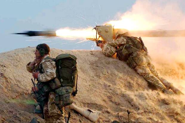 A British Royal Marine from 42 Commando fires a Milan wire-guided missile at an Iraqi position on the Al Faw peninsula in southern Iraq on March 21, 2003.