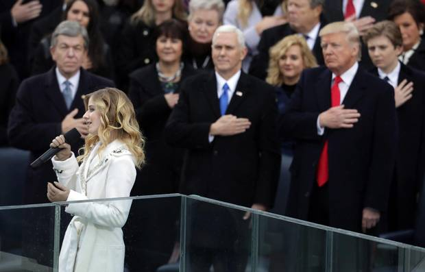 Jackie Evancho performs the national anthem as Vice-President Mike Pence and President Donald Trump watch.