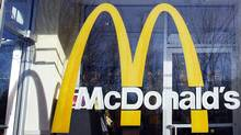 A McDonald's logo is seen on the window of one of its restaurants in New York in this January 24, 2011, file photo.  (Shannon Stapleton/Reuters)