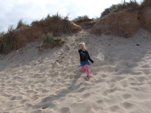 Playing on the dunes in North Norfolk.