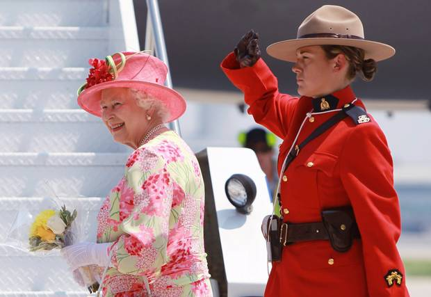 An RCMP officer salutes the Queen as she boards a plane at Toronto's Pearson International Airport on July 6, 2010.