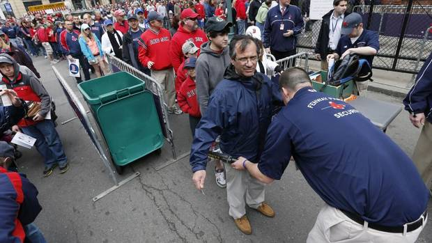 Fans pass through security before entering Fenway Park for a baseball game between the Boston Red Sox and the Kansas City Royals in Boston, Saturday, April 20, 2013. (Michael Dwyer/AP)