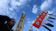 Assembly of First Nations Youth Council member Clayton Tootoosis takes part in a rally on Parliament Hill in Ottawa on Dec. 10, 2013. (SEAN KILPATRICK/THE CANADIAN PRESS)