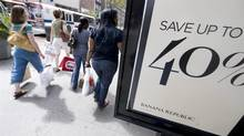 A Statistics Canada report due Nov. 22 that is expected to show retail sales across the country climbed by between about 0.3 per cent and 0.6 per cent in September. (RICHARD DREW/THE ASSOCIATED PRESS)