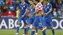 Italy's Andrea Pirlo (C) reacts next to his team mates Giorgio Chiellini (L) and Christian Maggio at the end of their Group C Euro 2012 soccer match against Croatia at the city stadium in Poznan June 14, 2012. (DOMINIC EBENBICHLER/REUTERS)