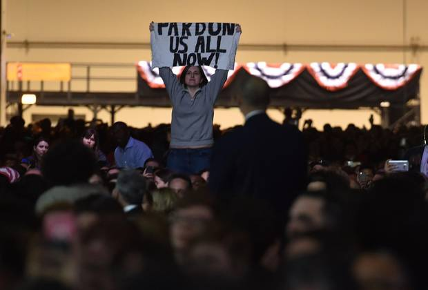A supporter holds up a sign as Mr. Obama speaks in Chicago.