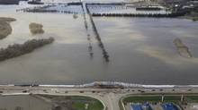 An aerial photo showns the Assiniboine River and 18th Street in the Brandon flood zone in Manitoba. Prime Minister Steven Harper toured the area Wednesday. (John Woods/The Canadian Press)