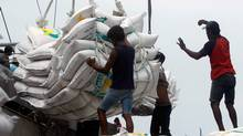 Workers unload 42,494 tonnes of Thai rice at the Tanjung Priok harbour in Jakarta January 25, 2011. (CRACK PALINGGI/Crack Palinggi/Reuters)