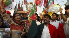 Supporters of the political party Pakistan Tehreek-e-Insaf (PTI) of Pakistani cricketer-turned-politician Imran Khan take part in a rally against alleged vote rigging in some polling stations during the general election, in Islamabad, May 13, 2013. (Zohra Bensemra/Reuters)