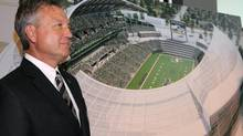 Saskatchewan Roughriders chair Roger Brandvold poses for photos during a public announcement about the Stadium Project in Regina (Michael Bell/THE CANADIAN PRESS)