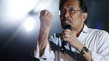 Malaysia's opposition leader, Anwar Ibrahim, is counting on the votes of a coalition of young Malays and the ethnic Chinese and Indian minorities to defeat the wealthy, powerful and long-ruling Malay elite. (BAZUKI MUHAMMAD/REUTERS)