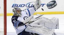 Winnipeg Jets goalie Ondrej Pavelec makes a save against the New Jersey Devils in the second period of their NHL hockey game in Newark, New Jersey, March 10, 2013. (RAY STUBBLEBINE/REUTERS)