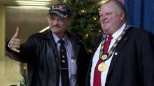 Toronto Mayor Rob Ford poses for a photo with a visitor as he greets Torontonians during the Mayor's New Year's Levee at Toronto's City Hall on January 1, 2013. (Chris Young For The Globe and Mail)