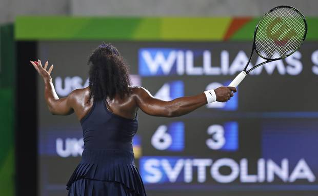 Serena Williams, of the United States, throws up her arms as she faces the scoreboard while trailing Elina Svitolina, of Ukraine, during the second set at the 2016 Summer Olympics in Rio de Janeiro, Brazil, Tuesday, Aug. 9, 2016